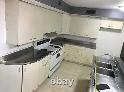 Vintage St. Charles Kitchen Cabinets and Elkay Stainless Steel Countertops